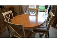 The pier rare round light wood/cream table with 4 chairs & cushions