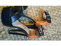 Size 4 black/orange summer high shoes cost £35