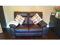 Two brown leather sofas, great condition. One is a sofabed
