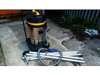 Gutter vacuum and high pressure washer