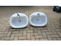 Bathroom sinks and toilet