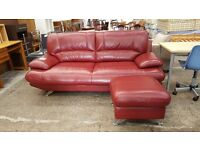 Modern red leather 2 seater sofa and pouffe set