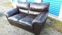 Brown leather couch set and ottoman