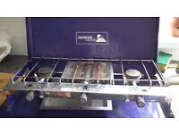 Double burner gas camping stove with grill and regulator