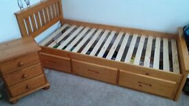 Single wooden bed with drawers and bedside cabnet