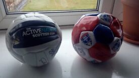 Two signed ross county footballs