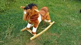 Cute rocking horse..... with realistic horse sounds and moving mouth