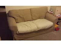 Two seater sofa (from Ikea), including all cushions, but no covers provided