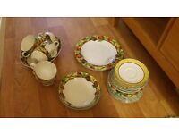 Daulton teacups. saucers. dinner plate and dish