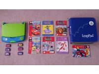 Leap Pad Learning System with cartridges +books + carry bag.