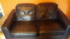 Two dark blue leather sofas. Decent condition. Must uplift before saturday