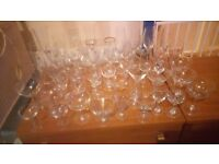 SELECTION OF ODD GLASSES, FROM SMALL CHAMPAGNE TO TALL WINE GLASSES