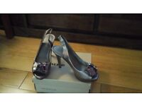 Silver high heel Nine West shoes.
