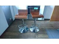 Two adjustable wooden stools