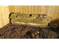 Selection of wooden sleepers for garden project.