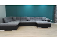 Ex Display Large Magnum Black & Grey Sofa Which Also Has A Bonus Pull Out Bed. Sizes In Description