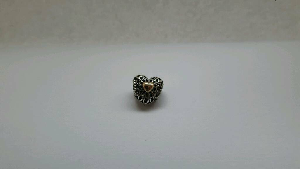 Silver with 14ct gold pandoras charm