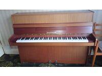 Zimmermann modern upright piano, light teak wooden cabinet.