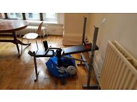 Weight Bench that includes 40.5kgs, two large poles, 4 dumbbell bars.