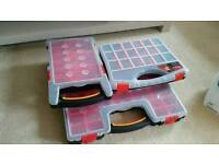 Three 3 storage compartment boxes screws and bits