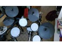 Electric drumset with mesh pads