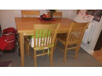 Solid pine dining table and matching chairs