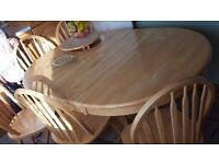 Expndable retractable dining table with 6 chairs for free