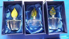 3x perfume bottles