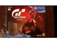 Brand new Ps4 slim with gran turismo and grand theft auto 5