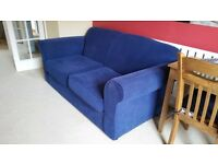 Blue 2 seater sofa in good condition from a smoke free home