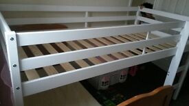 white wooden framed mid-sleeper bed. only used for 8months now needing to get bunkbeds