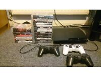 Playstation 3 with 25 games and 3 remote controls