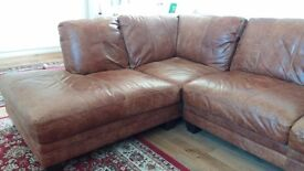 Leather corner sofa and matching footstall