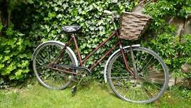 Vintage Ladies town bike with Basket, mudguards, chain guard and leather saddle.