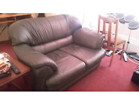 Free to a good home! - Two Seater Green Leather Sofa/Couch
