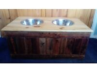 Dog bowl holder with storage for large dogs.
