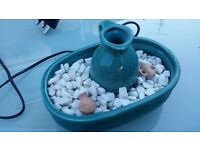 Beautiful indoor water fountain - Turquoise Greek styled Urn with white rocks and themed objects