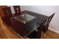 Quality glass and chrome dining table with 4 matching chairs