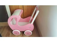 Beautiful Wooden Doll's pram - very good condition.