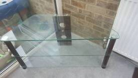 Corner TV stand glass and dark wood.