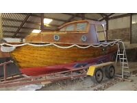 "'Sea Otter', a 20ft 6"" clinker built Norwegian motor cruiser, currently stored in Cardigan Bay"