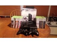 FOR SALE XBOX 360 250GB CONSOLE WITH TWO HAND CONTROLLERS AND 22 GAMES,