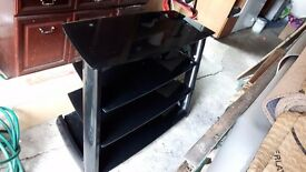 Solid black glass TV stand good condition
