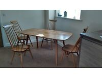 Ercol plank table with four goldsmiths chairs, not reproduction