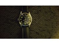 Ex paratrooper watch is a 50s wind up shock proof with great illumination. On a black face