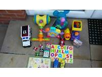 Large toy bundle including vehicles, cars, wooden jigsaws etc