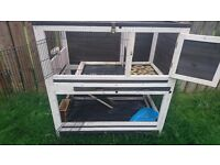 A two tier hutch suitable for guinea pigs or rabbits.