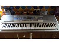 Yamaha DGX-200 Digital Portable Keyboard with carry case