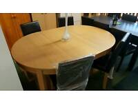 **BRAND NEW** new massey oval extending table + 4 midback chairs