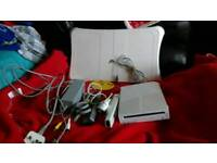 Wii console Wii fit and 2 games